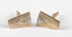 Pair of 14K yellow gold and diamond cufflinks.