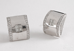 Pair of 18K white gold and diamond earrings.