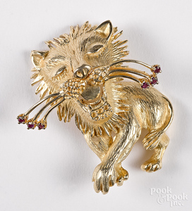 14K yellow gold gemstone lion pendant.