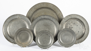 Seven English pewter plates and chargers, etc.