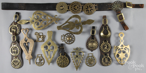 Collection of horse brasses and trivets.