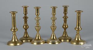 Three pairs of brass push-up candlesticks