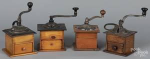 Four coffee grinders, with cast iron tops