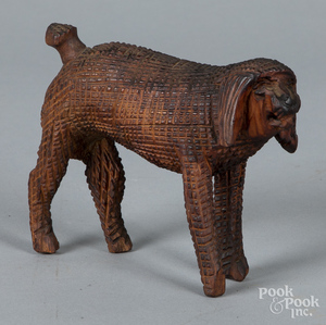 Carved dog, in the style of Aaron Mountz