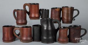 Eleven contemporary leather mugs