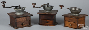 Three coffee grinders, with pewter bowls