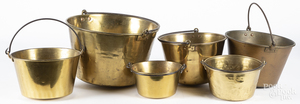 Six brass buckets
