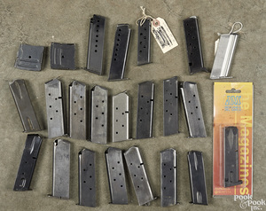 Twenty-three rifle and pistol magazines
