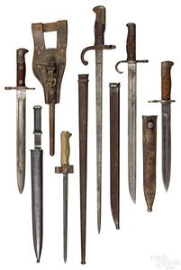 Five bayonets and scabbards