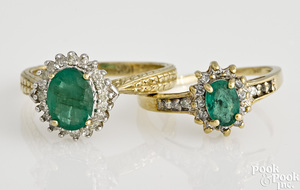 Two 10K yellow gold emerald and diamond rings