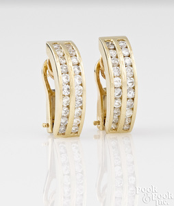 Pair of 14K yellow gold diamond earrings