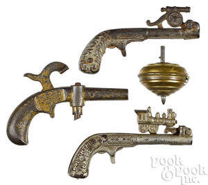 Three cast iron animated cap guns