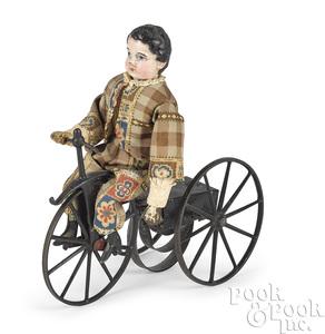 Composition boy riding clockwork velocipede