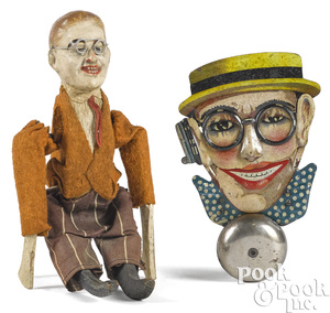 Two Harold Lloyd character toys