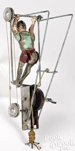 Gunthermann painted tin wind-up flying acrobat toy