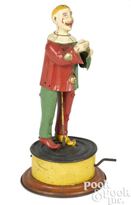 German tin mechanical hand crank dancing clown