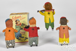 Four Schuco wind-up toys