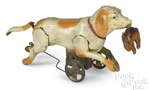 Gunthermann tin wind-up running dog with a rabbit