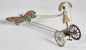 Tin wind-up butterfly pulling a ballerina toy