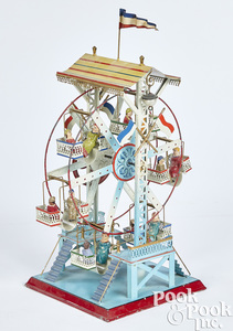 Doll & Cie painted and embossed tin Ferris wheel