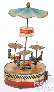 Painted and lithograph tin carousel steam toy