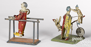 Two painted tin clowns steam toy accessories
