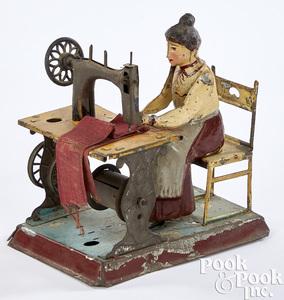Gunthermann tin woman at sewing machine steam toy
