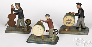 Three painted tin musician steam toy accessories