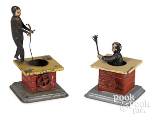 Two Becker chimney sweep steam toy accessories