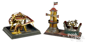 Two painted tin waterwheel steam toy accessories
