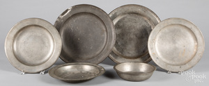 Six pewter chargers and deep dishes, 9