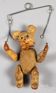 Wind-up trapeze bear