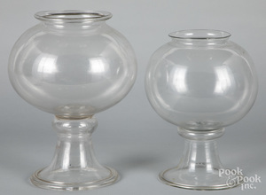 Two blown colorless glass apothecary jars