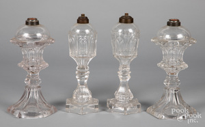 Two pairs of colorless glass whale oil lamps