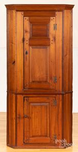 Diminutive pine one-piece corner cupboard