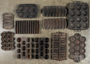 Collection of cast iron food molds.