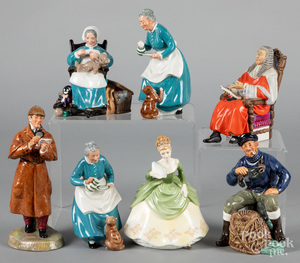 Seven Royal Doulton figures.