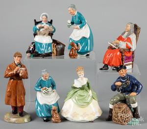 Seven Royal Doulton figures.