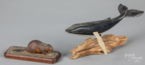 Carved and painted humpback whale and beaver