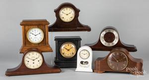 Seven assorted mantel clocks.