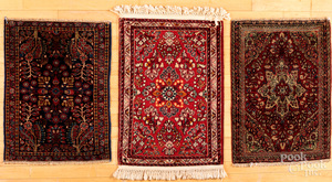Three Sarouk mats.