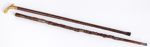 Carved cane with silver plaque, etc.