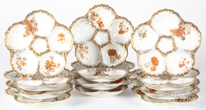 Set of twelve Limoges porcelain oyster plates