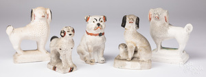 Five chalkware dogs