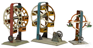 Three painted tin Ferris wheel steam toy accessories