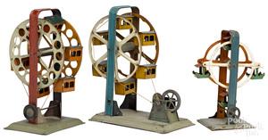 Three painted tin Ferris wheel steam toy accessories