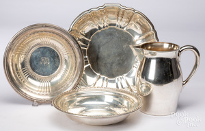 Three sterling silver bowls and a pitcher