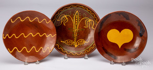 Three Breininger redware chargers