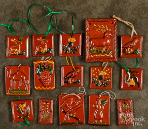 Fifteen Shooner redware Christmas ornaments.