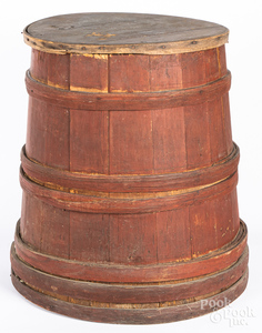 Large red painted barrel